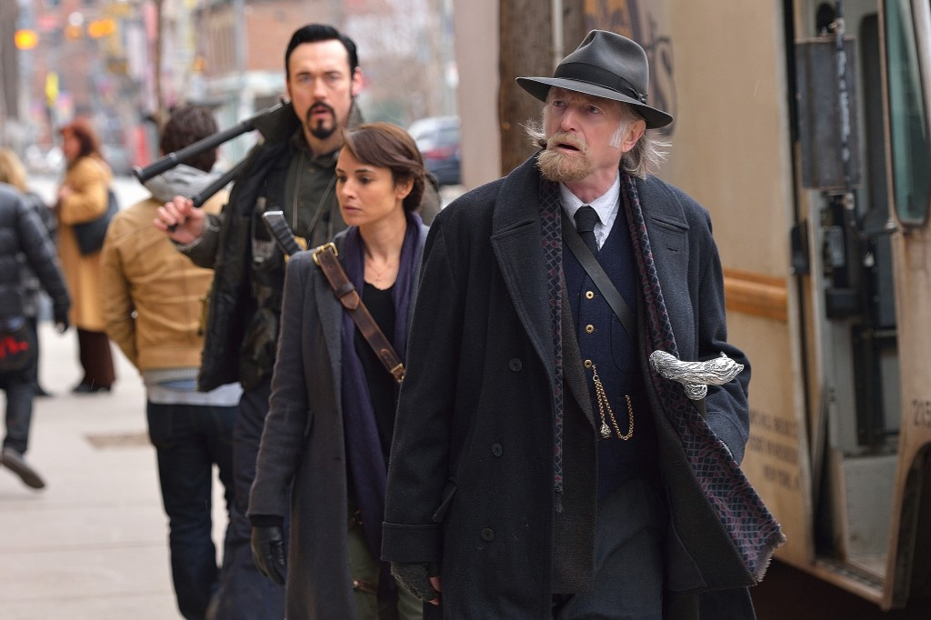 "THE STRAIN -- ""The Assassin"" -- Episode 210 (Airs September 13, 10:00 pm e/p) Pictured: (front to back) David Bradley as Abraham Setrakian, Mia Maestro as Nora Martinez, Kevin Durand as Vasiliy Fet. CR: Michael Gibson/FX"