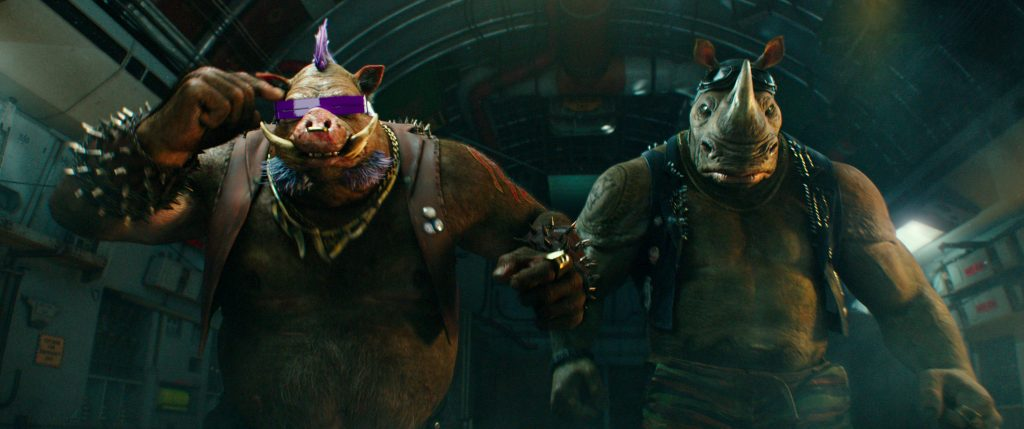 Left to right: Bebop and Rocksteady in in Teenage Mutant Ninja Turtles: Out of the Shadows from Paramount Pictures, Nickelodeon Movies and Platinum Dunes Productions