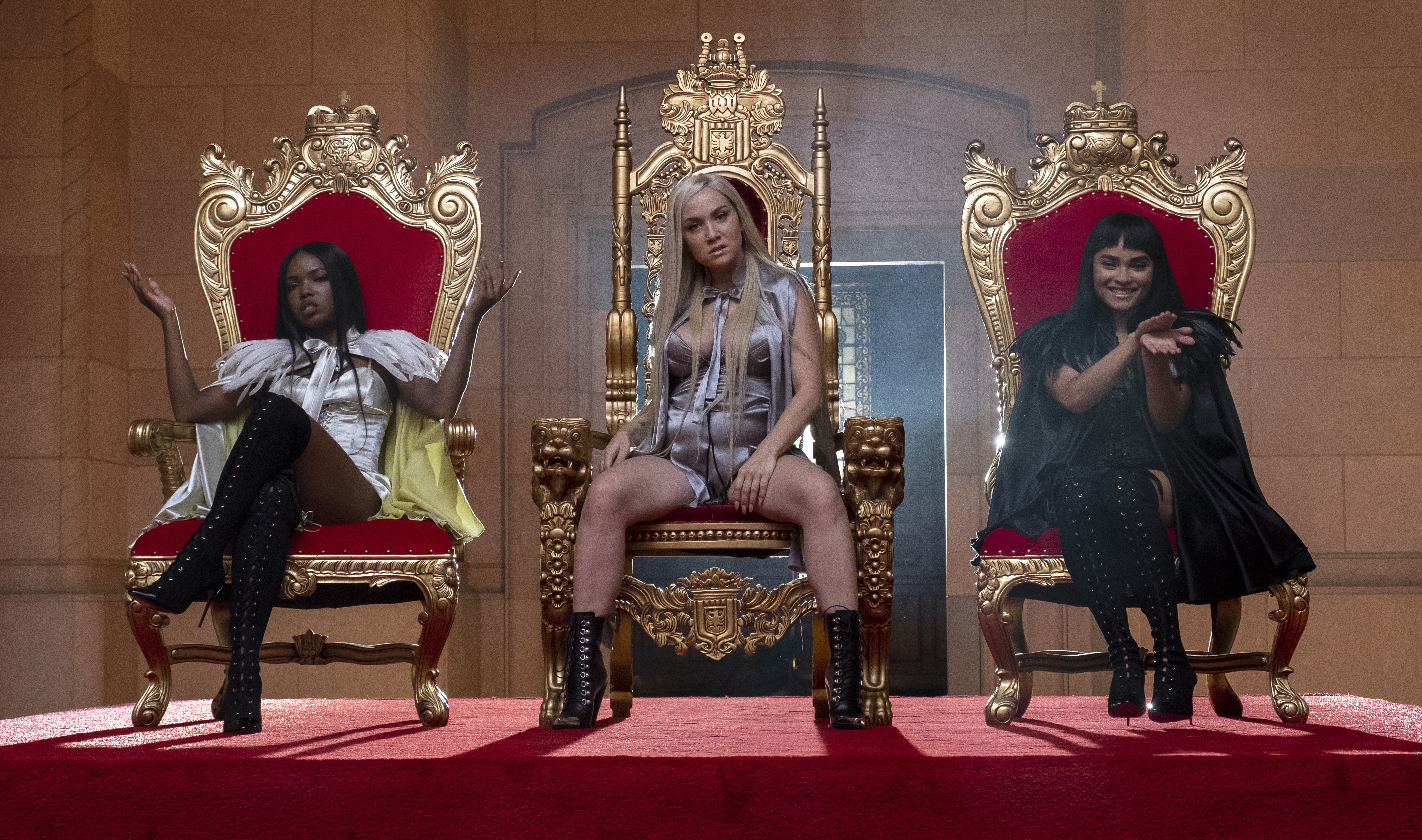 """Take 3's Alex, Star, and Simone sitting on thrones in the music video for """"Madonna"""" on STAR"""