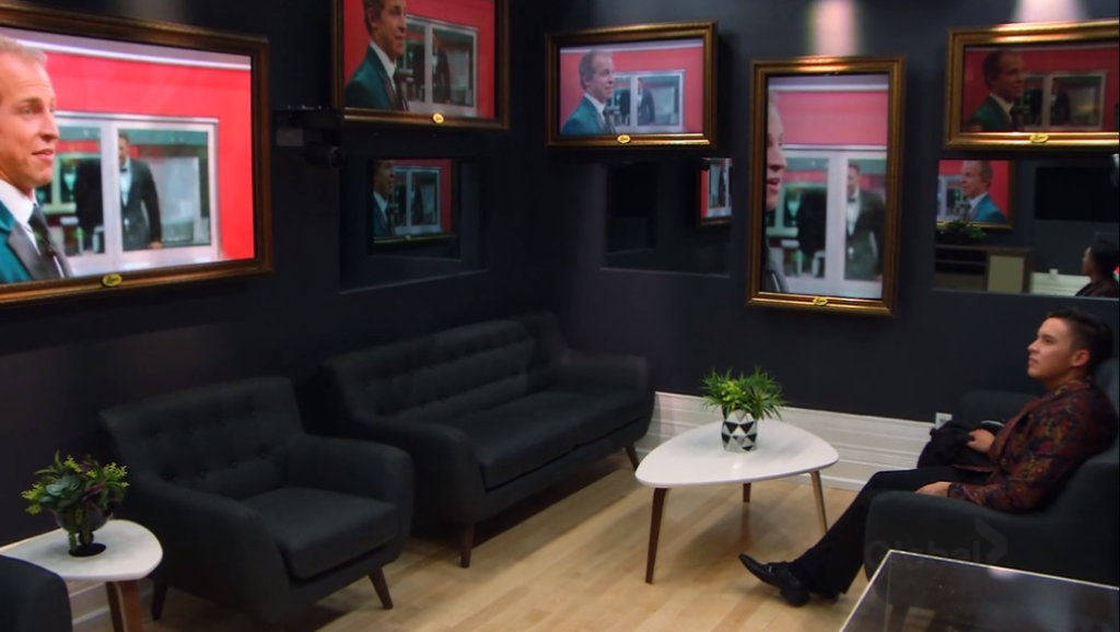 Damien watching Dane and Adam in the secret room on Big Brother Canada 7