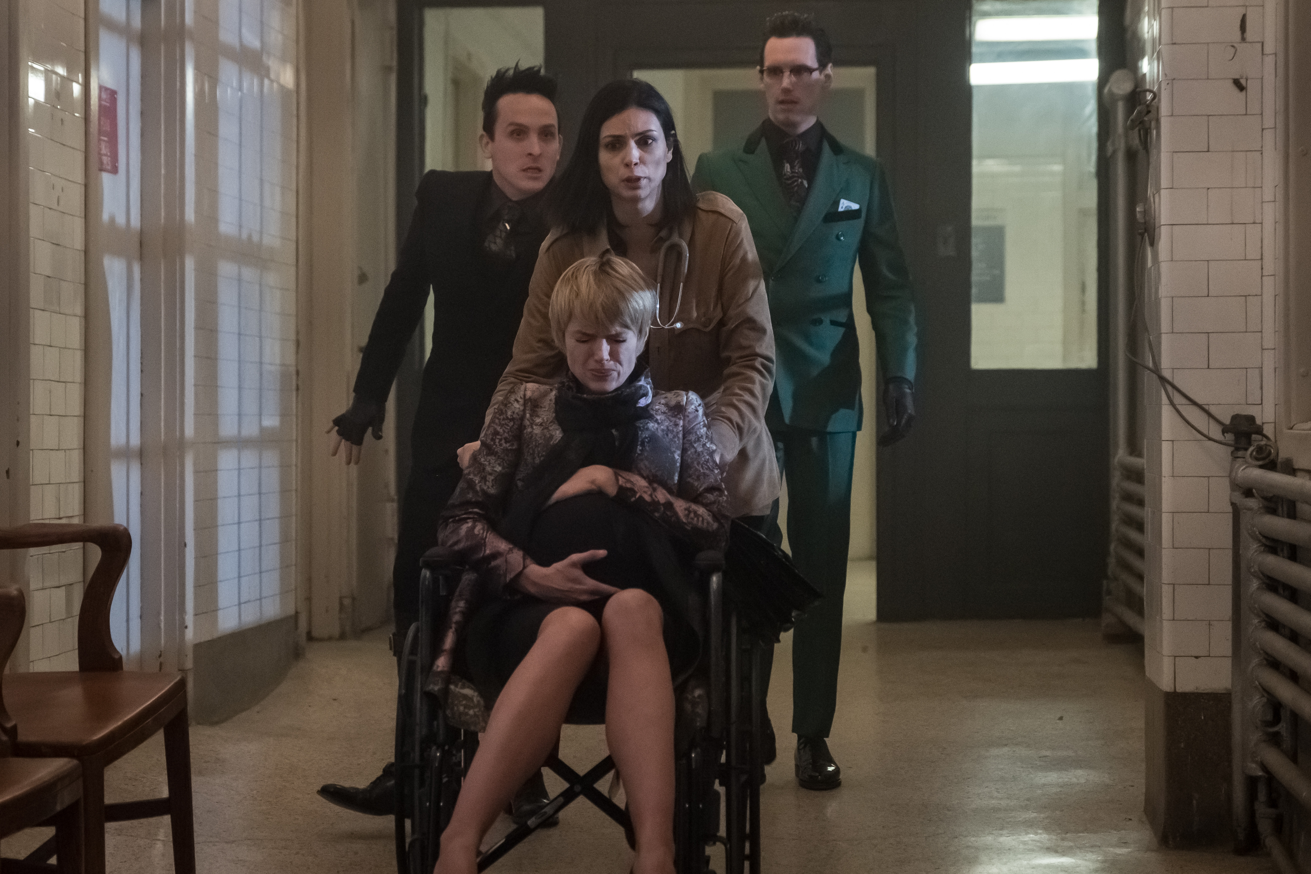 Lee, Riddler, and Penguin moving Barbara Kean while in labor on Gotham