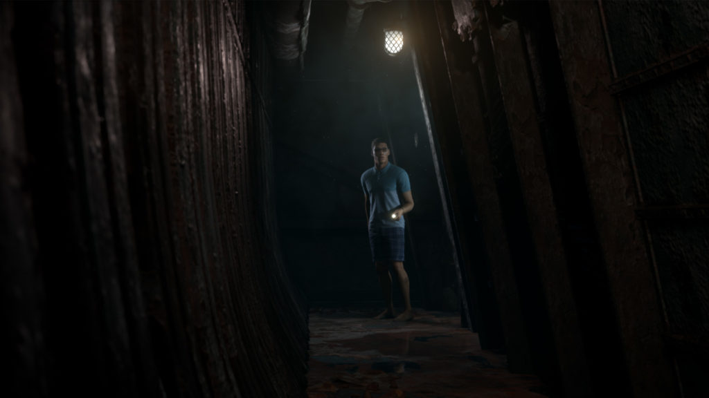 Brad walking down a hallway in Man of Medan