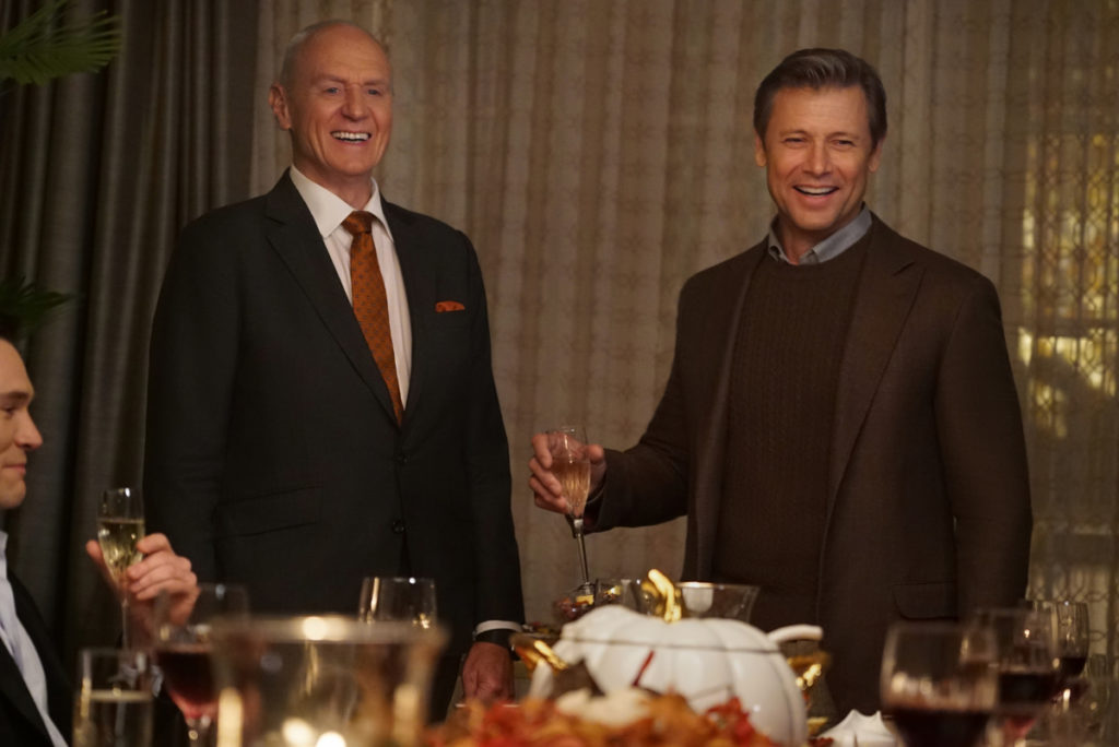 Anders and Blake cheering at dinner on Dynasty
