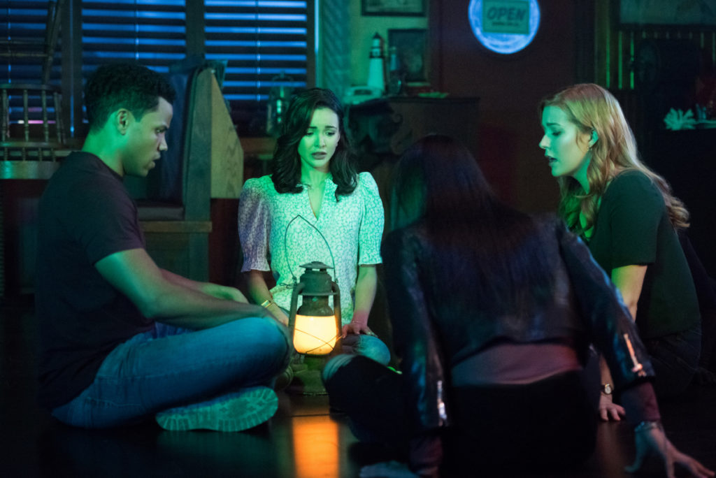 Nick, Bess, George, and Nancy conduct a seance on Nancy Drew
