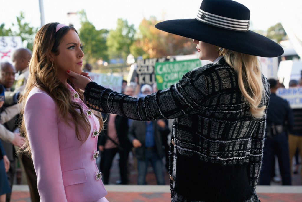 Fallon and Alexis Carrington outside the courthouse on Dynasty