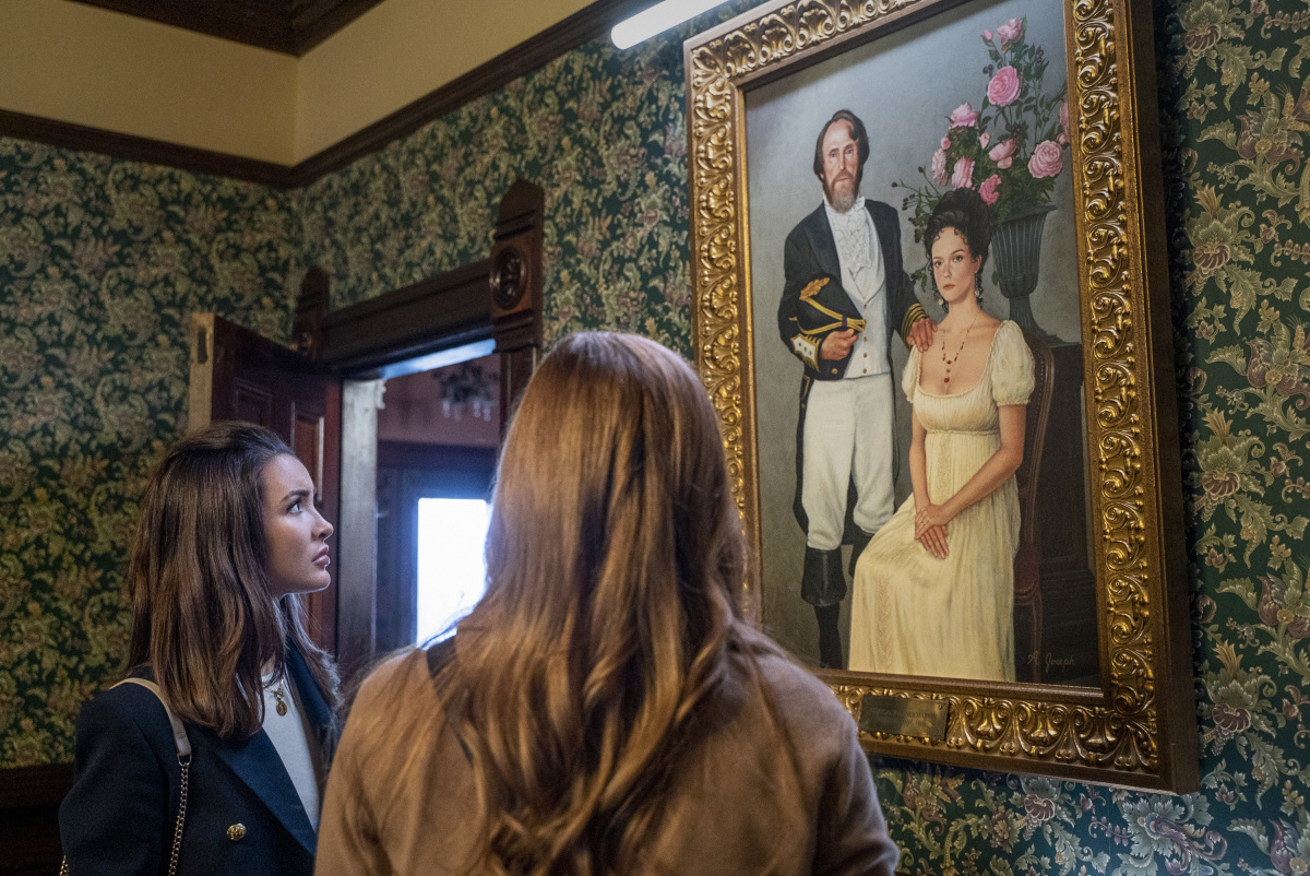 Nancy and Bess viewing a historical painting on Nancy Drew