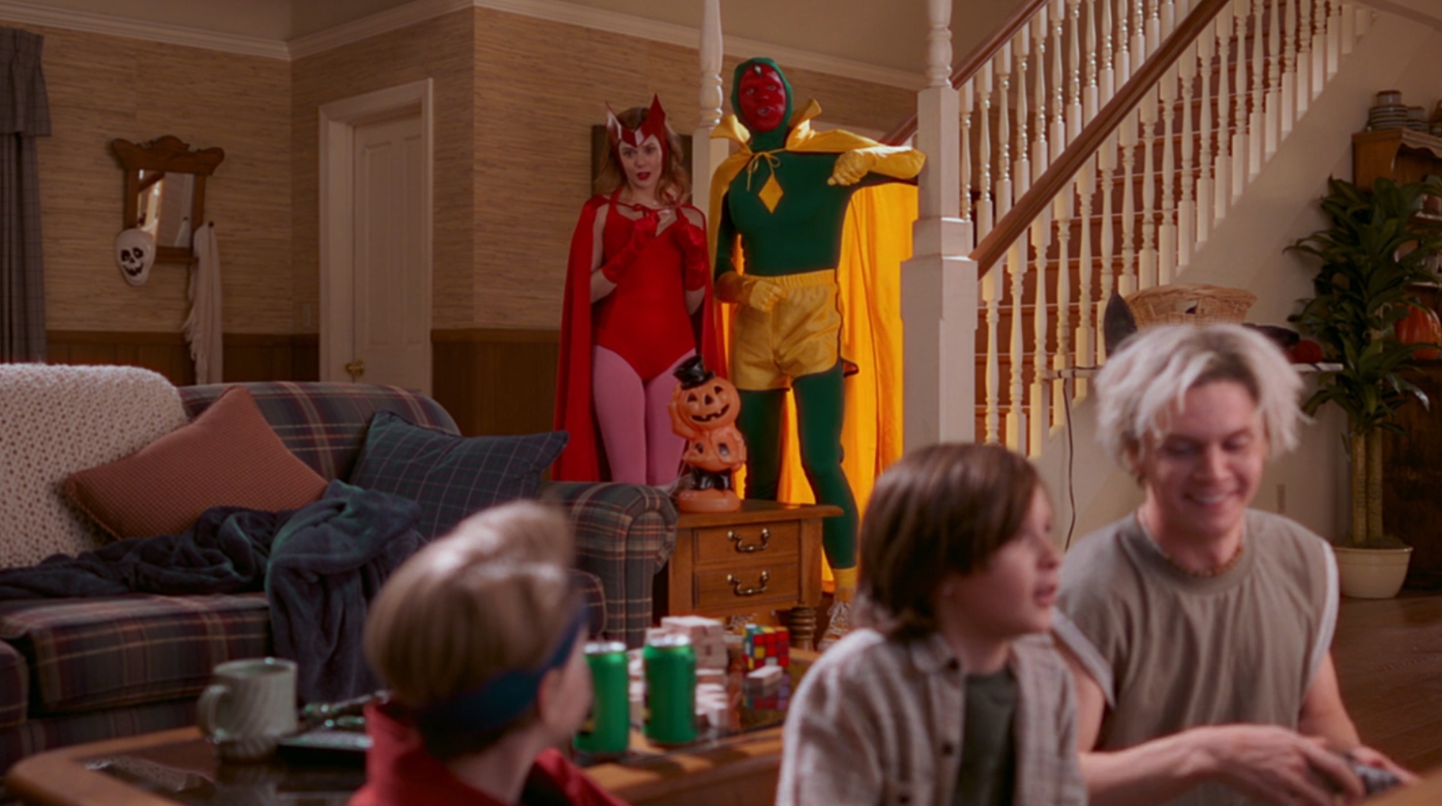 Wanda and Vision don comic book accurate costumes for Halloween in WandaVision episode 6.
