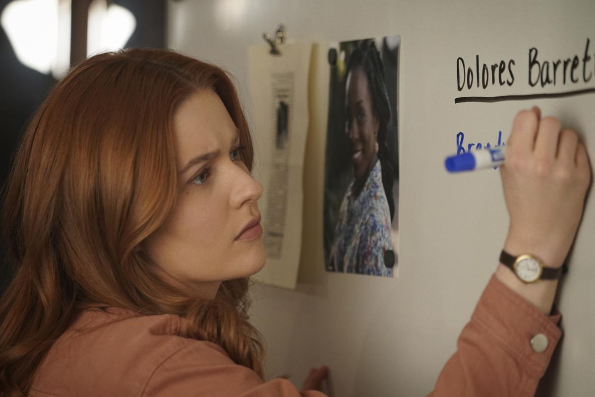 Nancy writing on Dolores board Nancy Drew